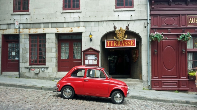 Cobblestone streets and red car in Old Montreal