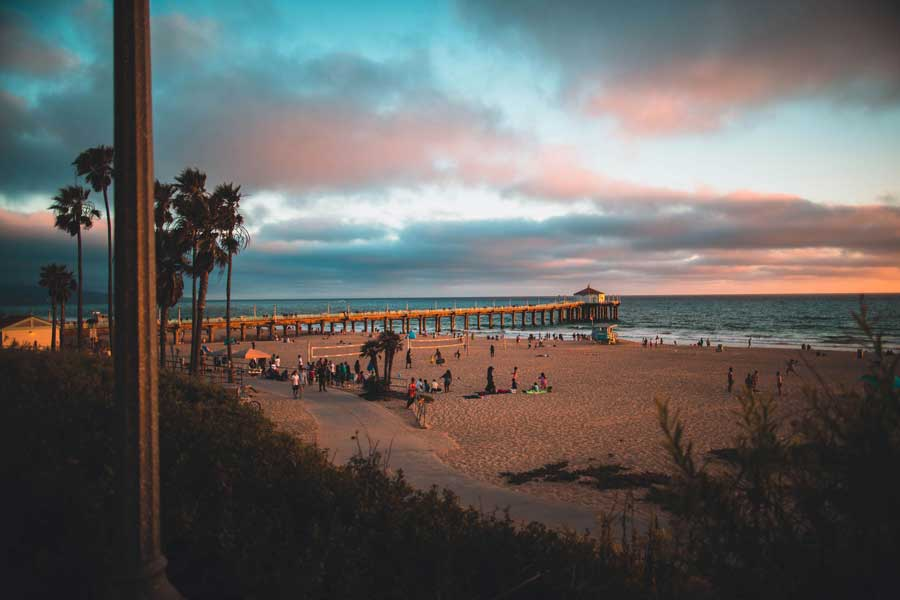 Sunset glow at Manhattan Beach and Pier along The Strand, Los Angeles