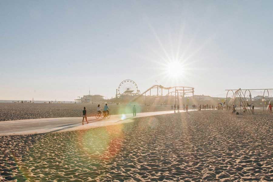 Sunbeams above Santa Monica Beach and Pier, Los Angeles