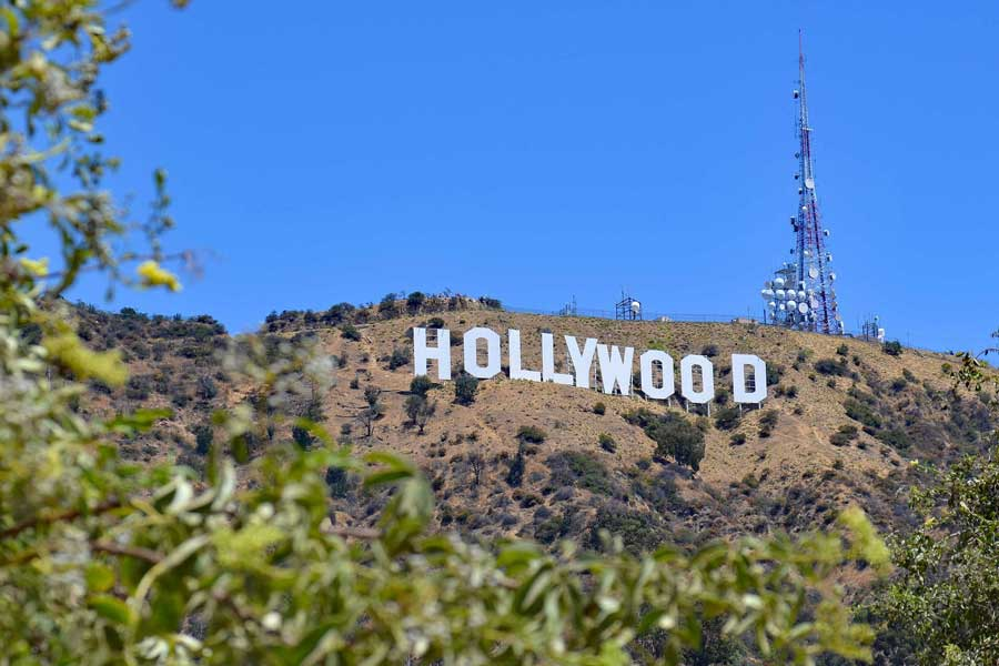 The iconic Hollywood sign on a sunny day in Los Angeles