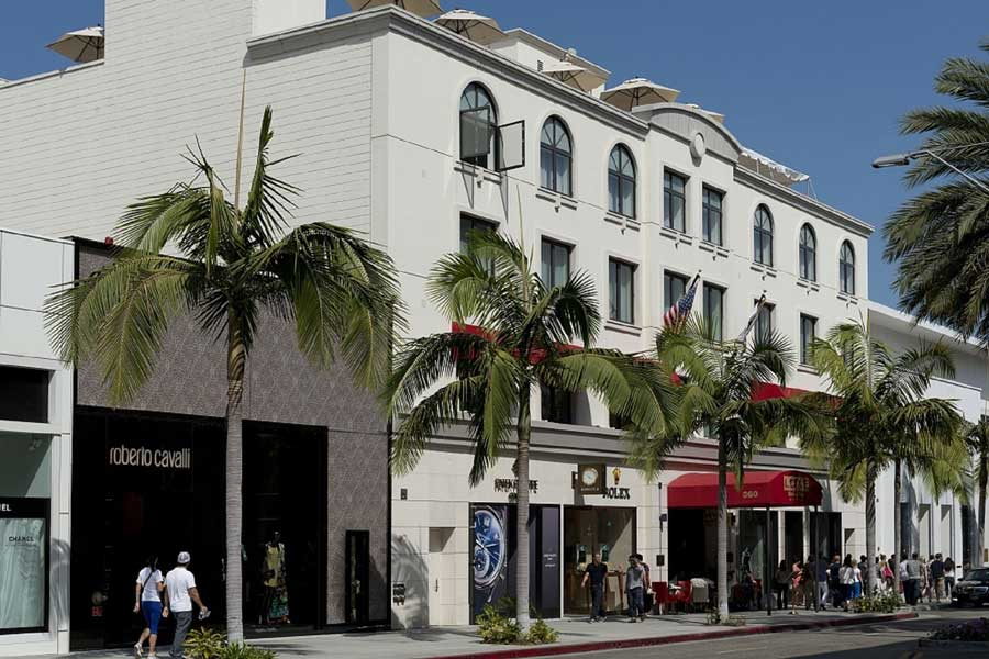 Red canopy of Luxe Hotel welcomes guests on Rodeo Drive, Los Angeles
