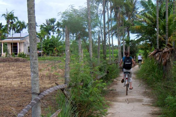 Cycling past a small farm in Vietnam's countryside