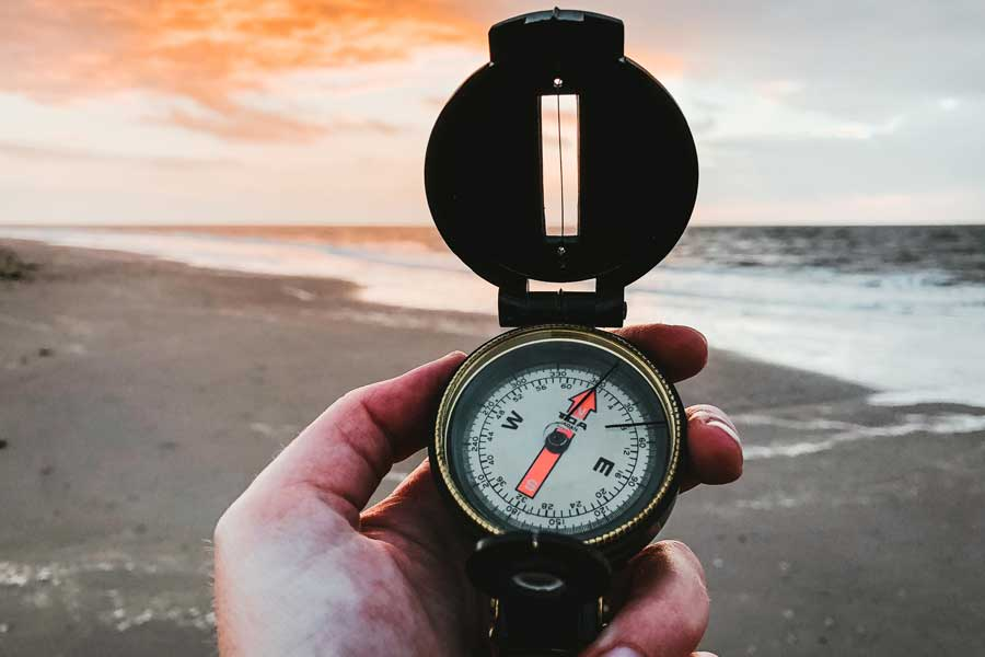 Compass guiding you along the beach at sunset