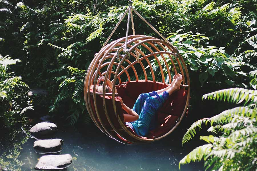 Swaying in a tree swing surrounded by jungle and water