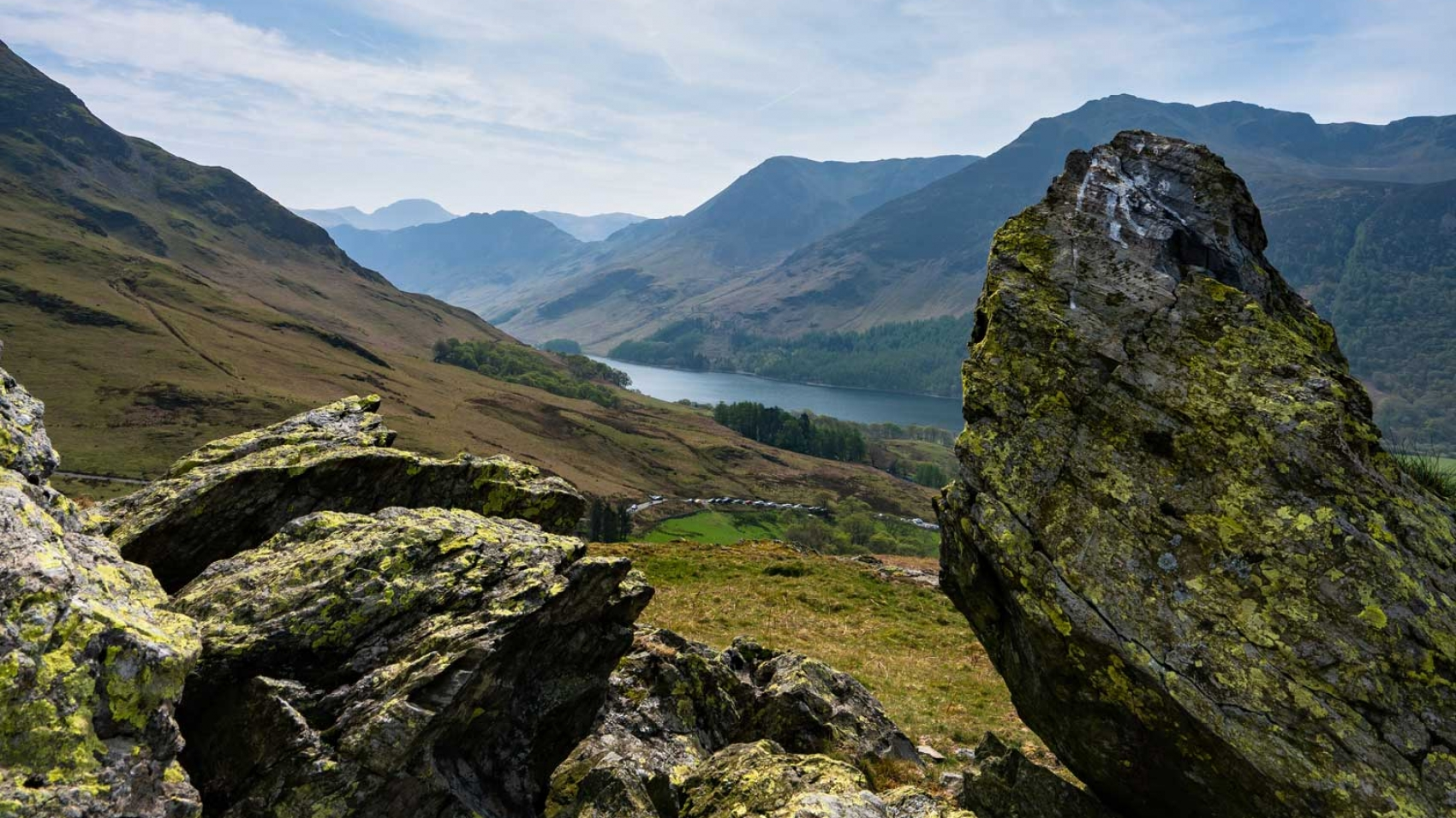Idyllic views of glistening lakes surrounded by rugged peaks in Lake District, England