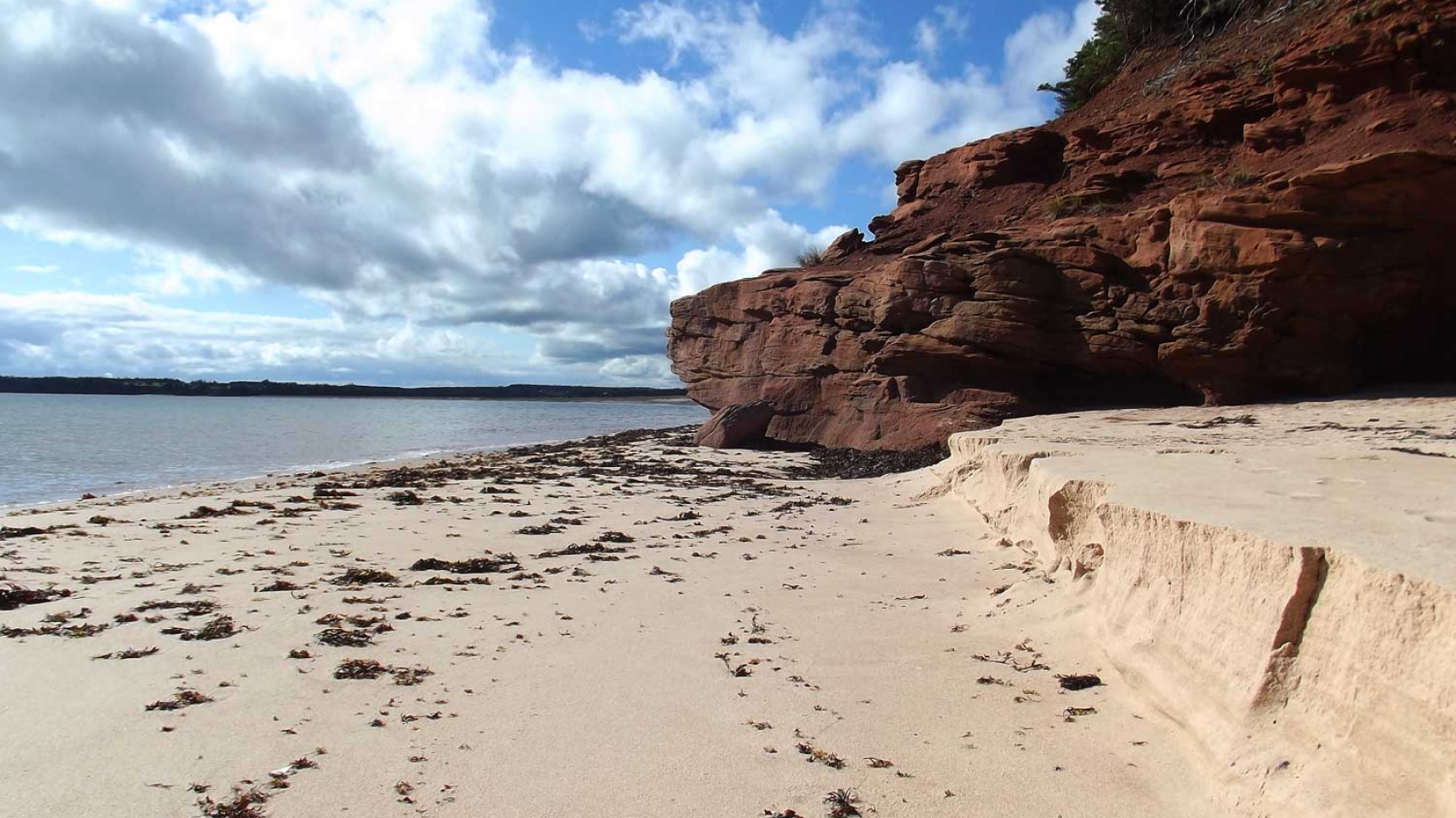 Stunning red cliffs and sandy beaches of PEI