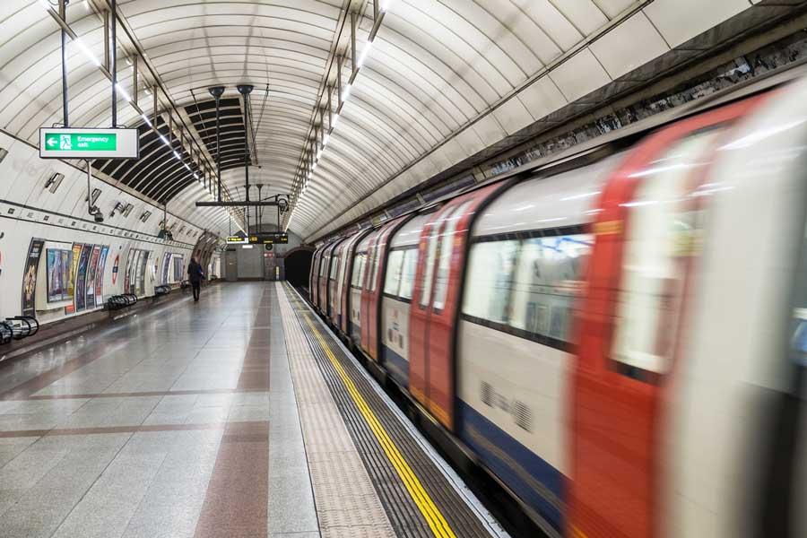 London Tube speeding by in underground station