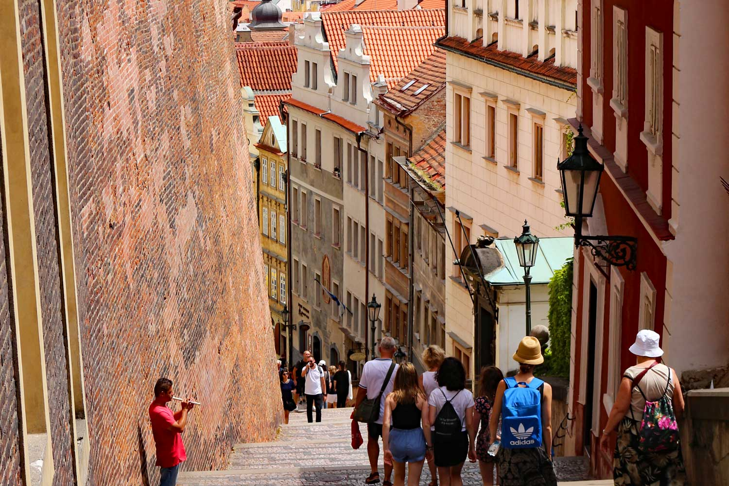 Mother and daughter walk down steps of Prague