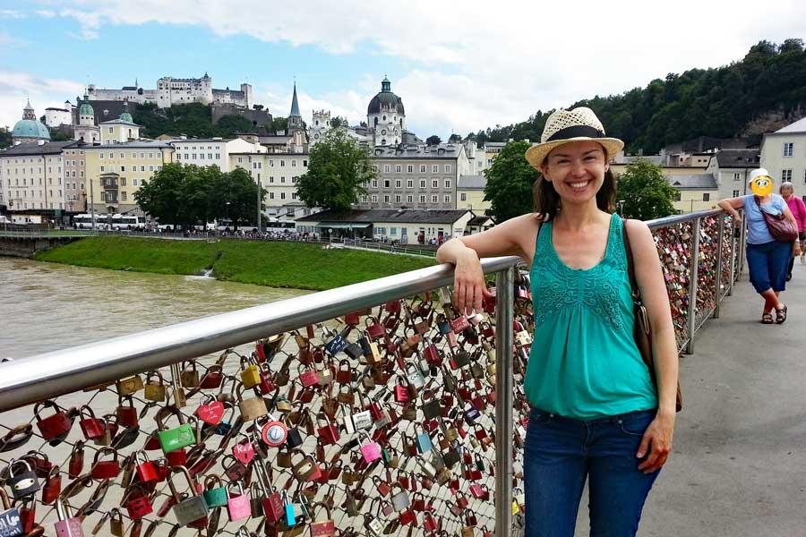 Mother and daughter unintentionally posing the same on love lock bridge, Salzburg
