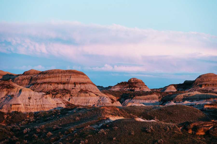 A romantic sun setting on the canyons of Alberta's Badlands