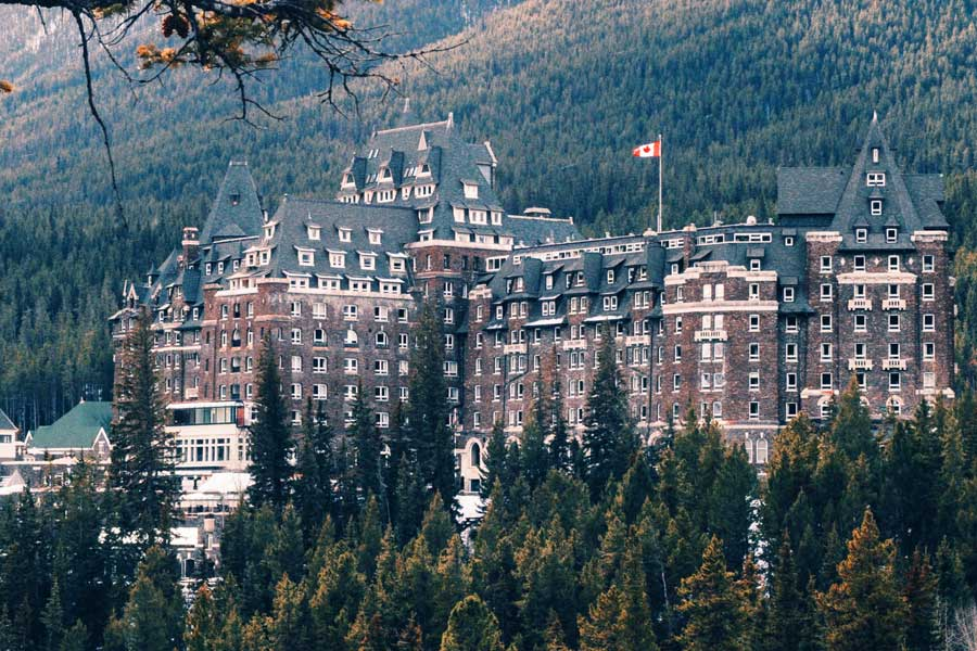 Romantic weekend near Calgary, romantic Fairmont Banff Springs Hotel surrounded by mountains and forest