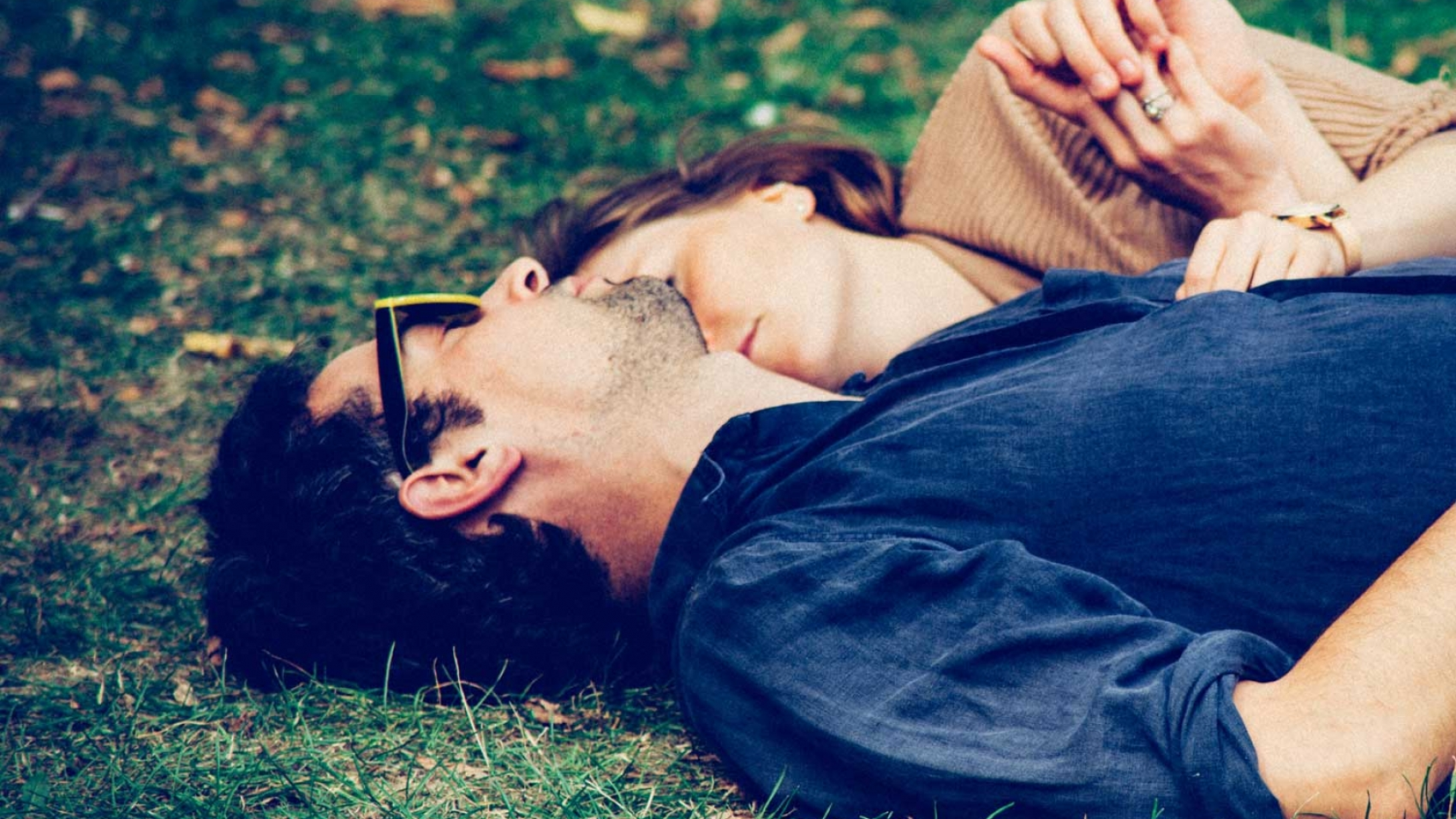 Couple relaxing in park in England