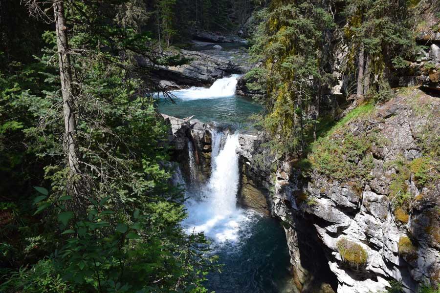 Falls cascade down Johnston Canyon.