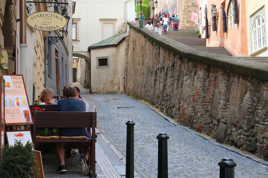 Narrow cobblestone streets beside Prague Castle steps