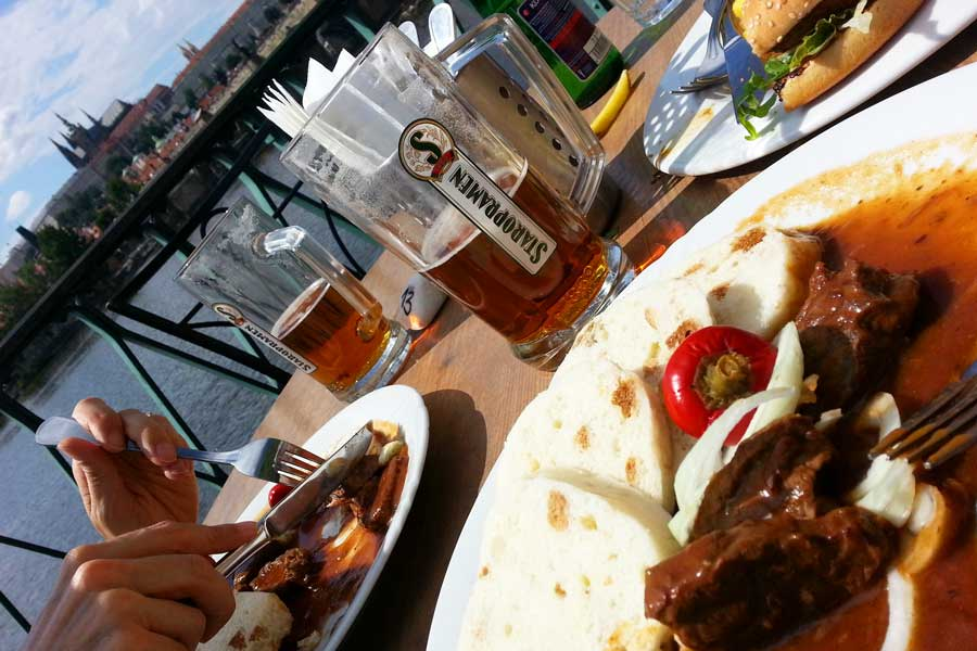 Lunch and beer overlooking Vltava River and Prague Castle