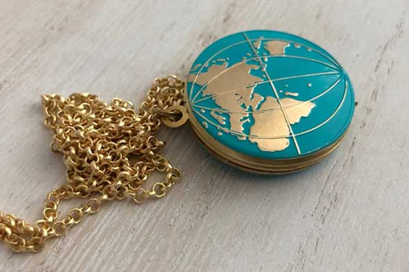 Travel gift ideas for students studying abroad, Globe locket necklace