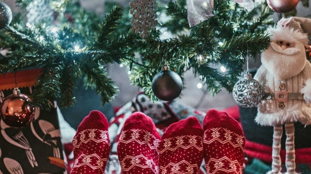 Festive socks and Christmas tree, Christmas vacation ideas for couples