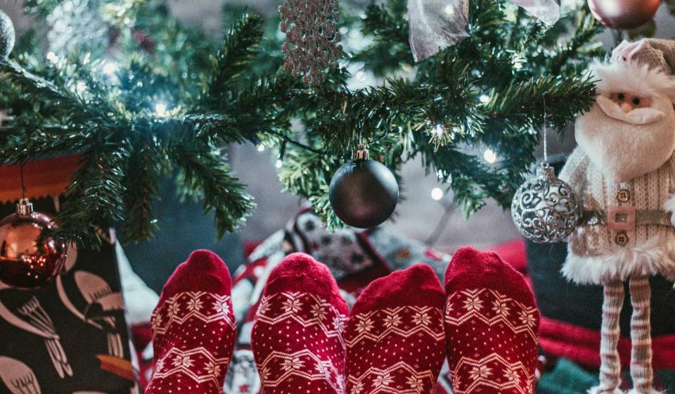 Festive socks and Christmas tree, Christmas vacation ideas for couples