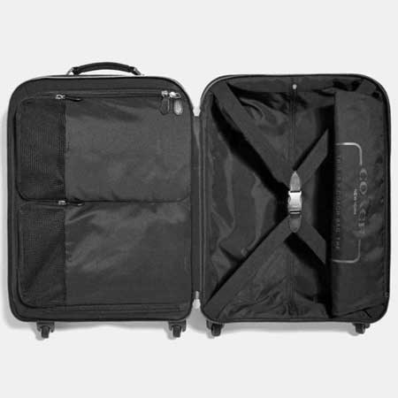 Luxury travel carryon bags for her, best luxury travel gifts for her, designer Coach