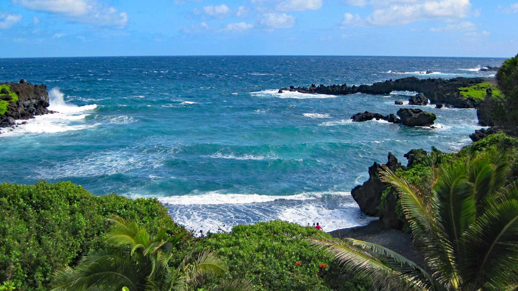 Black sand at Honokalani Beach, Road to Hana views, areas to stay in Maui