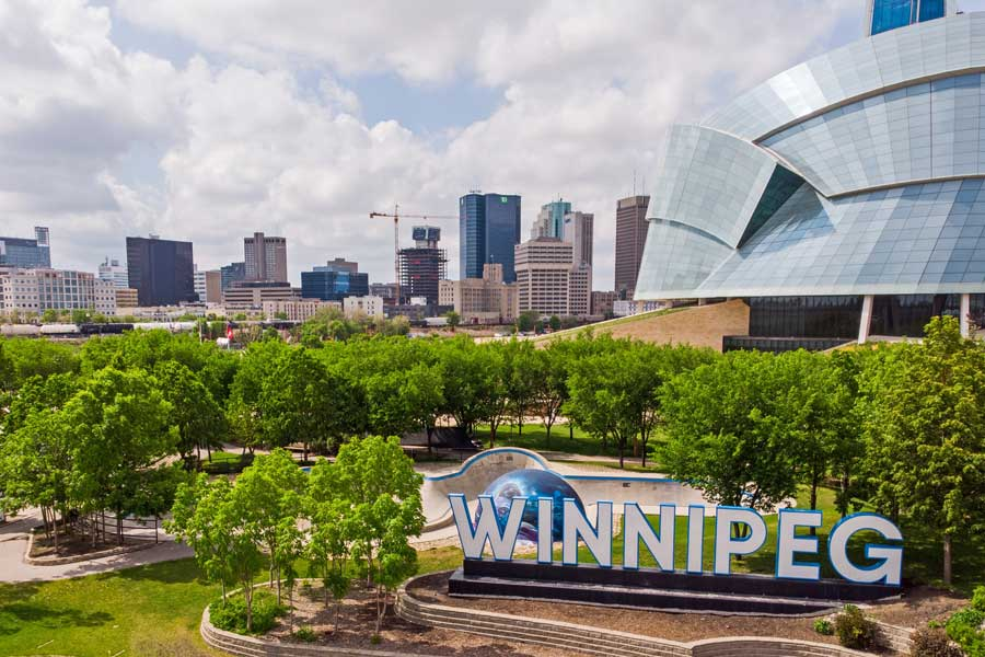 Winnipeg city sign, Toronto to Vancouver drive, cross-Canada road trip map and route ideas