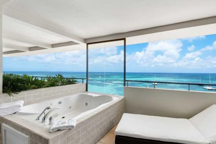 Luxury beach vacation ideas for couples at Christmas, romantic beach getaways, Caribbean resorts, Barcelo Aruba resorts